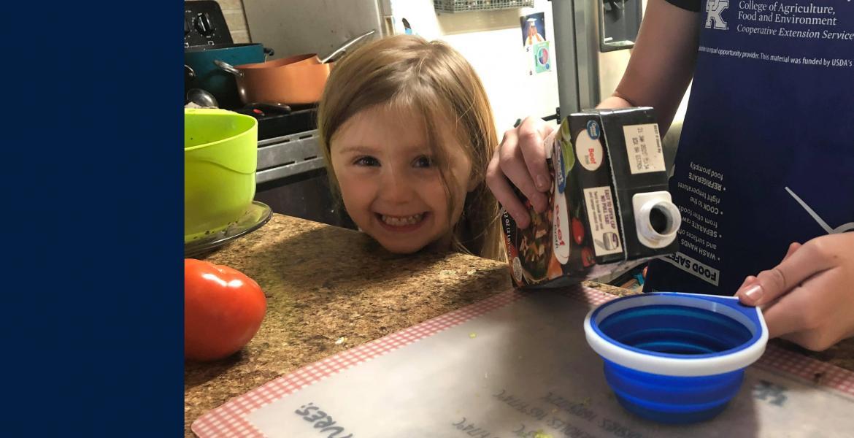 child in kitchen