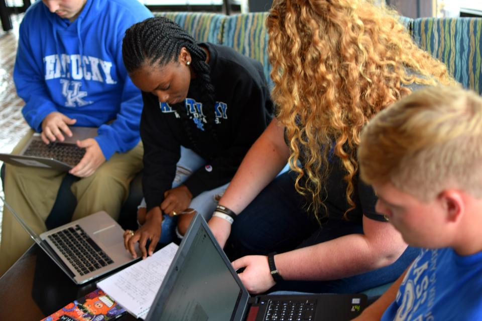 students working and studying together seated